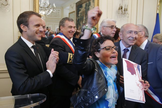 French President Emmanuel Macron (L) and French Interior Minister Gerard Collomb (R) react as Zhou El Wafi becomes a French citizen in Orleans. Photo by Michel Euler/pool/EPA