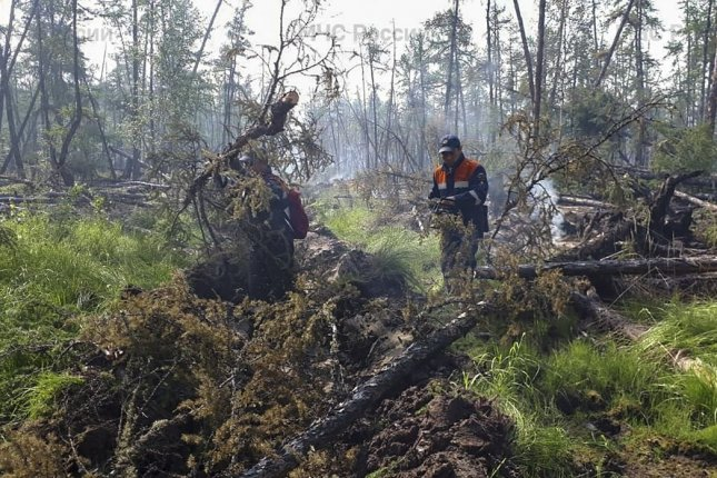 Firefighters worked on the wildfire in the Republic of Sakha, or Yakutia, Thursday. Photo courtesy of Russian Emergencies Ministry/EPA-EFE