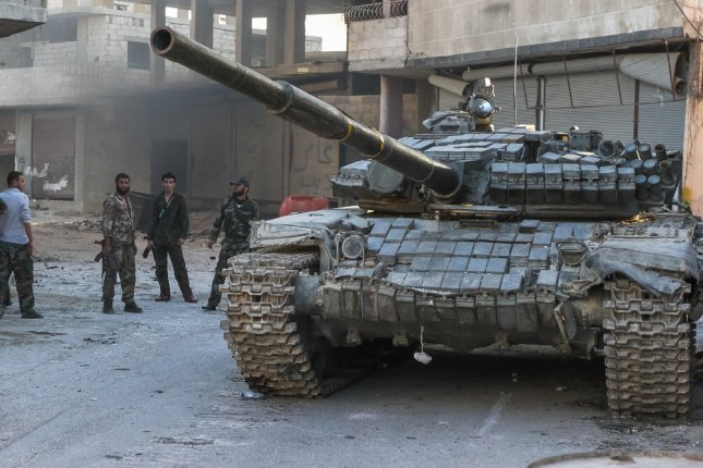 Syrian regime troops stand near a tank during fighting with rebels in Damascus in 2013. Al-Nusra front has 10,000 operatives in Syria and elsewhere, and was responsible for the massacre of 200,000 Druze minority members. On Wednesday, South Korea police said they arrested a man for supporting the group on social media. Photo by Volodymyr Borodin/Shutterstock