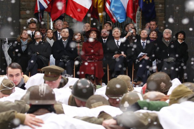 U.S. Defense Secretary Mark Esper, Polish President Andrzej Duda, Queen Mathilde of Belgium, King Philippe of Belgium, Great Duke Henry of Luxembourg and German President Frank-Walter Steinmeier attend a ceremony Monday to commemorate the 75th anniversary of the Battle of the Bulge at the Mardasson Memorial in Bastogne, Belgium. Photo by Julien Warnand/EPA-EFE
