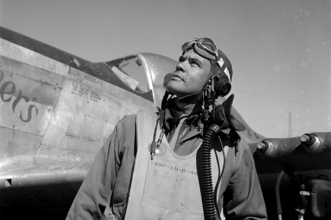 Col. Benjamin O. Davis, commander of the 332d Fighter Group, the Tuskegee Airmen, next to his Curtiss P-40 Warhawk in Rametti, Italy. Picture taken by Toni Frissell in March 1945. File Photo by Library of Congress/UPI