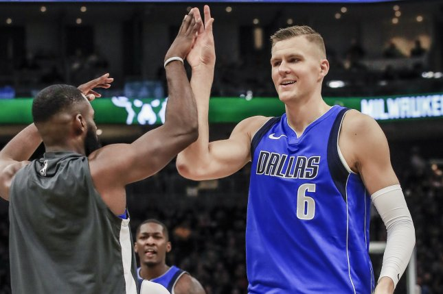 Dallas Mavericks forward Kristaps Porzingis (R), shown Dec. 16, 2019, missed the team's previous three games because of a sprained left ankle. File Photo by Tannen Maury/EPA-EFE