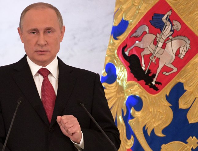 Russian President Vladimir Putin delivers his annual address to the Federal Assembly at the Kremlin in Moscow on December 1. Photo by Alexei Druzhinin/Sputnik/Kremlin Pool/European Pressphoto Agency