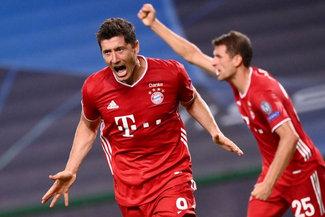 Bayern Munich striker Robert Lewandowski (L) celebrates after scoring during their UEFA Champions League semifinal match against Olympique Lyon on Wednesday in Lisbon, Portugal. Photo by Franck Fife/EPA-EFE