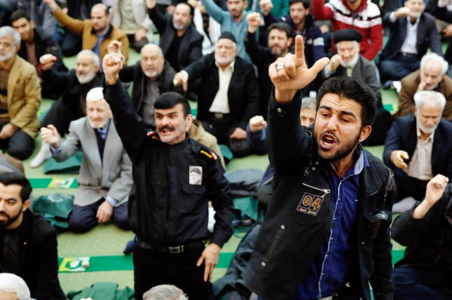 Iranian worshipers shout slogans against anti-government protesters, the United States and Israel during the Friday prayer ceremony at the Imam Khomeini mosque in Tehran, Iran. Photo by Abedin Taherkenareh/EPA-EFE
