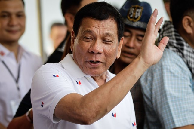 Philippine President Rodrigo Duterte waves goodbye to Vietnamese fishermen during the send-off ceremony for the Vietnamese fishermen in Sual province of Pangasinan, north of Manila, Philippines on November 2. Duterte is set to declare the lagoon in the Scarborough Shoal a marine sanctuary, ending a long dispute with China. Photo by Mark R. Cristino/European Press Agency