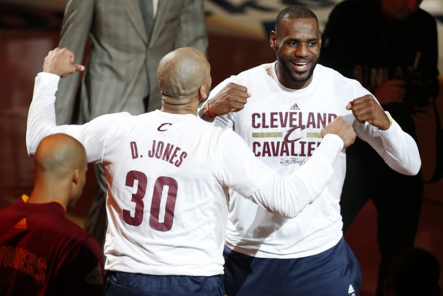 8854f20beb9 Cleveland Cavaliers forward LeBron James (R) said he will pay teammate Dahntay  Jones  fine after he was docked  6