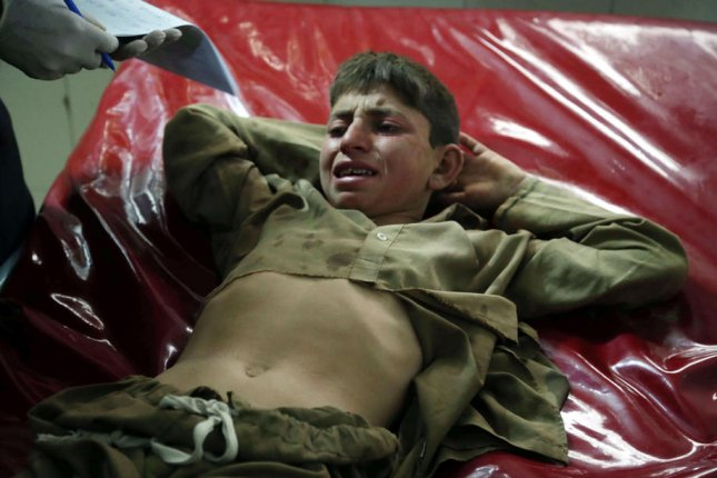 A boy receives treatment at a Jalalabad, Afghanistan, hospital on October 18, 2019, after he was injured in an explosion in Nangarhar province. File Photo by Ghulamullah Habibi/EPA-EFE