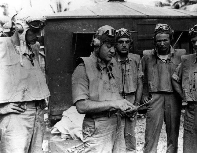 Lieutenant Colonel Gregory Pappy Boyington instructing pilots for a flight over Rabaul, some time on or after Dec. 17, 1943. File Photo by U.S. Navy/UPI