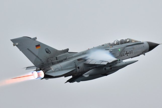 One of the two Tornado reconnaissance jets of Germany's Tactical Air Force Wing 33 takes off for the NATO air base in Incirlik, Turkey, on January 5. The German Cabinet on Wednesday approved the withdrawal of all German troops and aircraft from the Turkish base as part of a dispute. File Photo by Harald Tittle/EPA