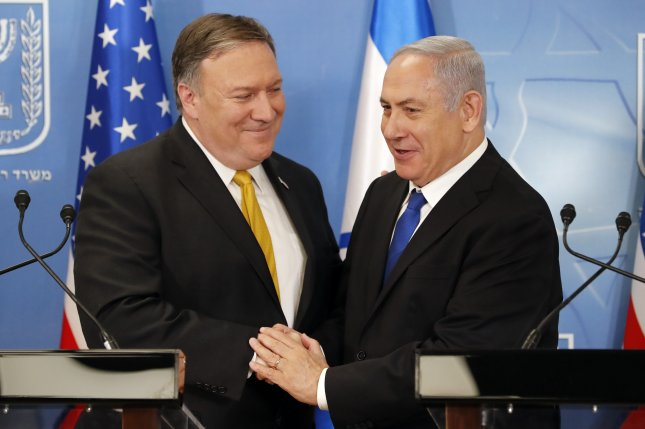 Secretary of State Mike Pompeo (L) is greeted by Israeli Prime Minister Benjamin Netanyahu ahead of a news conference at the Ministry of Defence in Tel Aviv, on Sunday. Photo by Thomas Coex/EPA/pool