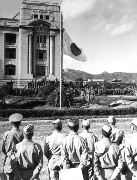 Japanese forces surrender to U.S. troops in Seoul on September 9, 1945, one day after U.S. forces arrived in southern Korea. File Photo courtesy of the U.S. Navy