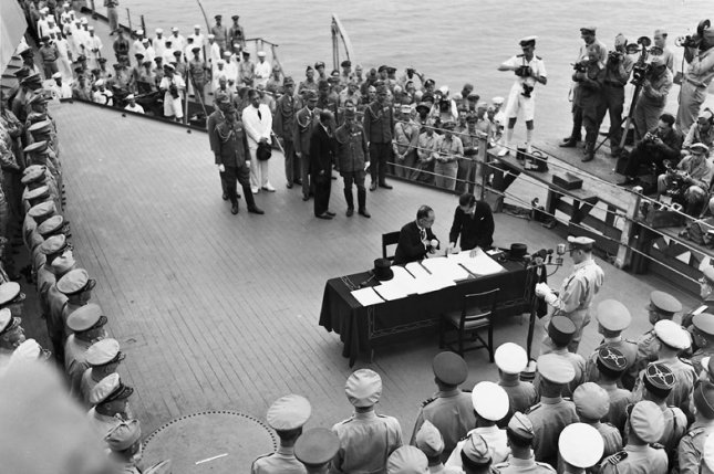 Foreign Minister Mamoru Shigemitsu and Gen. Yoshijiro Umezu of Japan sign the complete capitulation of Japan on September 2, 1945, aboard the USS Missouri in Tokyo. Photo by Ed Hoffman/UPI