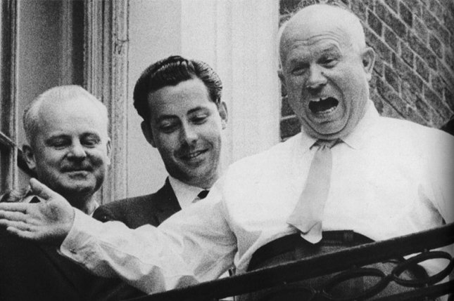 Soviet Premier Nikita Khrushchev (R) shouts This is my America at a New York cabbie from his window at the Russian U.N. delegation's headquarters during the 1960 United Nations' General Assembly. File Photo by Gary Haynes/UPI