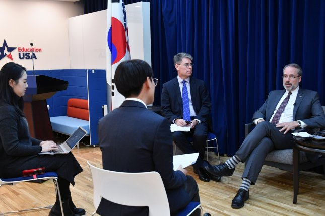 James DeHart (R), the U.S. negotiator for defense cost-sharing, has resumed meetings with South Korean counterparts in 2020. File Photo by Yonhap/EPA-EFE