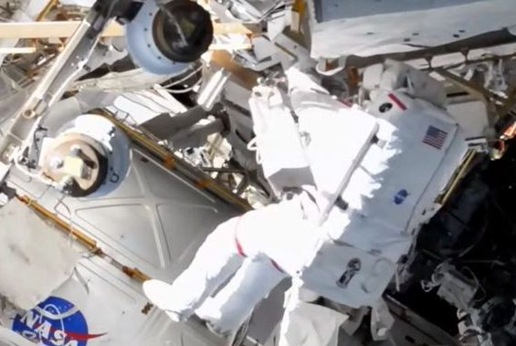 French astronaut Thomas Pesquet returns to an airlock during a spacewalk Wednesday at the International Space Station. Photo courtesy of NASA