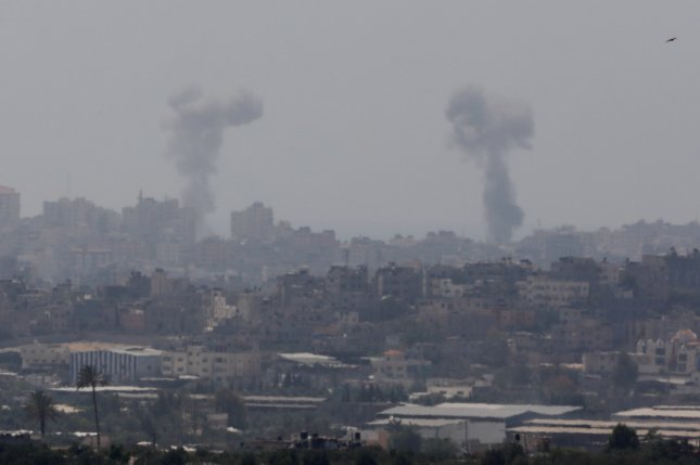 Smoke rise after Israeli Air Force strike on northern Gaza Strip in the border with Gaza on Tuesday. Israel conducted air raids targeting 15 Hamas locations along the Gaza strip early Sunday morning after intercepting missiles that were fired from Gaza. Photo by Abir Sultan/EPA