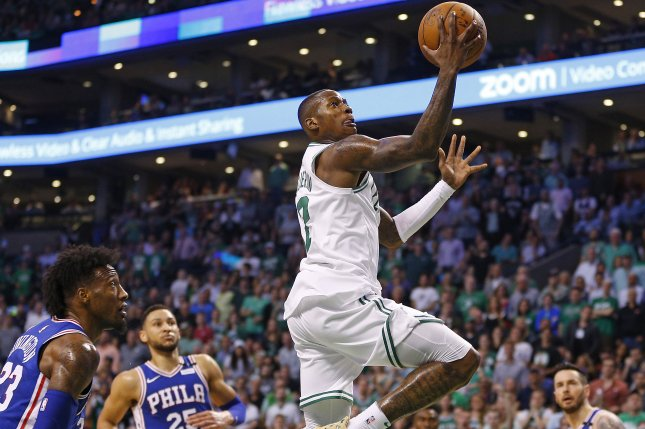 Boston Celtics guard Terry Rozier (R) makes a shot past defending Philadelphia 76ers forward Robert Covington (L) during the second quarter Game 2 of the NBA Eastern Conference first round game two between the Boston Celtics and the Philadelphia 76ers on May 3 at the TD Garden in Boston, Mass. Photo by C.J. Gunther/EPA-EFE/Shutterstock