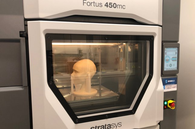 NASCAR used a 3D printer at its Research and Development Center in Concord, N.C., to print a replica of a human head for medical professionals at Wake Forest University so they can refine COVID-19 protection techniques. Photo courtesy of NASCAR