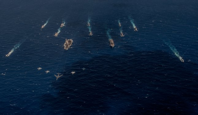 A B-1 bomber from the 34th Expeditionary Bomb Squadron leads a formation with fighters in front of U.S. Navy and Japanese surface vessels during Exercise Keen Sword 17, which took place Oct. 30 to Nov. 11, 2016. Photo by Petty Officer 3rd Class Nathan Burke/U.S. Navy