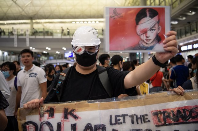 A man wears an eyepatch to protest police violence during a sit-in at Hong Kong  International Airport Tuesday. Photo by Laurel Chor/EPA-EFE