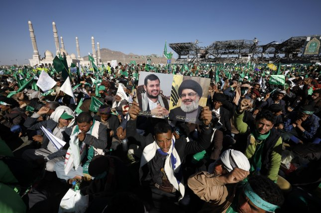 Supporters rallyduring a Mawlid celebration, which marks the birth anniversary ofthe Muslim prophet Muhammad on October 29.One attendee holds photos of Lebanese Hezbollah chief Hassan Nasrallah (R) and Shiite Houthi movement leader Abdul-Malik al-Houthi.Photo by Yahya Arhab/EPA-EFE