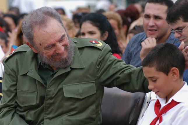 epa05648038 A picture made available 26 November 2016 shows Cuban President Fidel Castro (L) with Elian Gonzalez during a sixth grade graduation ceremony in Cardenas, 150 km east of Havana, Cuba, 21 July 2005. Current Cuban president, Raul Castro, announced on 25 November 2016 his brother's death on the Cuban state TV. Cuban former President Fidel Castro has died at the age of 90. EPA/Randy Rodriguez