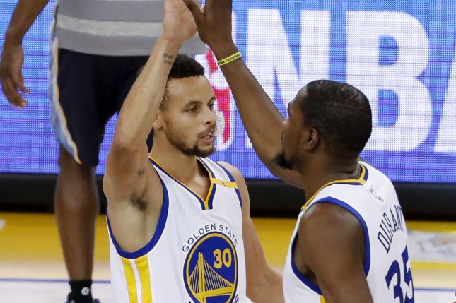 Golden State Warriors forward Kevin Durant (R) is greeted by Golden State Warriors guard Stephen Curry (L) after Durant scored a three point jumper against the Memphis Grizzlies during the first half of the NBA basketball game between the Memphis Grizzlies and the Golden State Warriors at the Oracle Arena in Oakland on January 6, 2017. File photo by JOHN G. MABANGLO/EPA
