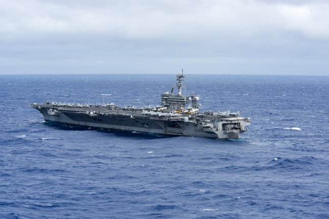 The U.S. Navy aircraft carrier USS Carl Vinson is seen traveling in the Philippine Sea on Friday. The Carl Vinson Strike Group is on a regularly scheduled western Pacific deployment -- specifically in the South China Sea -- as part of the U.S. Pacific Feet-led initiative to extend the command and control functions of U.S. 3rd Fleet. Photo by Kurtis A. Hatcher/U.S. Navy