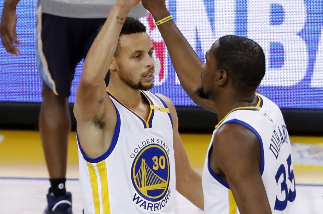 b2a70e4d17d9 Golden State Warriors forward Kevin Durant (R) is greeted by Golden State  Warriors guard Stephen Curry (L) after Durant scored a three point jumper  against ...