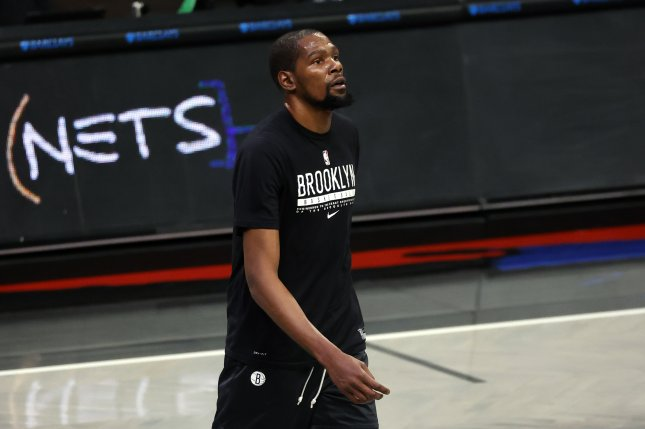 Brooklyn Nets forward Kevin Durant, seen before a game against the New York Knicks on April 5, suffered a left thigh contusion during Sunday's matchup against the Miami Heat. File Photo by Jason Szenes/EPA-EFE