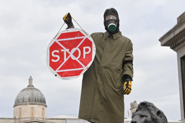 An Extinction Rebellion supporter blocks the road in Trafalgar square Monday in London, Great Britain. Photo by Facundo Arrizabalaga/EPA-EFE