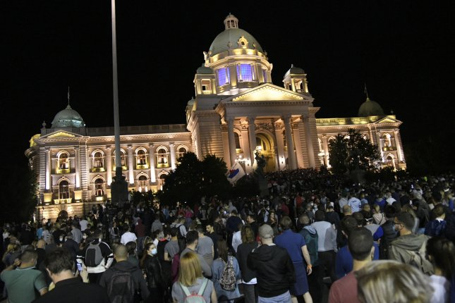 Thousands of people in Serbia gathered in front of the National Assembly Building in Belgrade on Tuesday night to protest a weekend curfew announced by President Aleksandar Vucic. Photo by Andrej Cukic/EPA-EFE