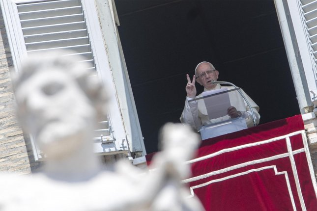Pope Francis speaks during his Sunday Angelus Prayer from his office's window overlooking St. Peter's Square at the Vatican on July 29. Photo by Massimo Percossi/EPA-EFE