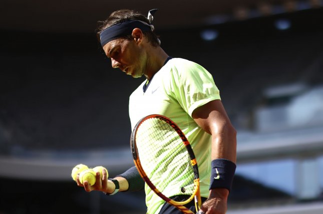 Rafael Nadal of Spain (pictured) takes on rival Novak Djokovic of Serbia in a semifinal match at the 2021 French Open on Friday in Paris.Photo by Yoan Valat/EPA-EFE