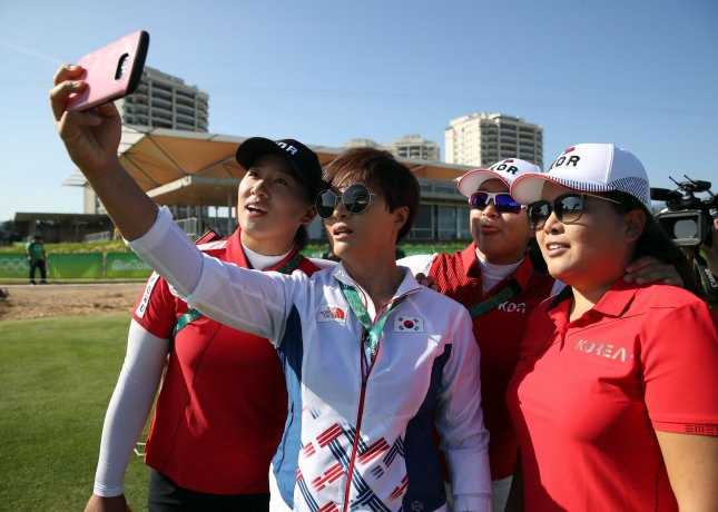 Members of South Korea's women's golf team take a selfie at the Olympic Golf Course in Rio de Janeiro on Aug. 13, 2016. From left to right are Yang Hee-young, coach Pak Se-ri, Kim Sei-young and Park In-bee. Photo by Yonhap News Agency/UPI