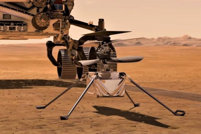 A NASA illustration shows the Mars helicopter Ingenuity on the surface of the Red Planet in preparation for its first flight. Image courtesy of NASA