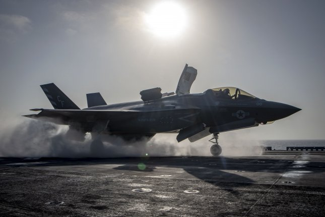 An F-35B Lightning II aircraft, assigned to Marine Fighter Attack Squadron 211, 13th Marine Expeditionary Unit, launches aboard the Wasp-class amphibious assault ship USS Essex as part of the F-35B's first combat strike on Sept. 27, 2018. Photo by Mass Communication Specialist 3rd Class Matthew Freeman/U.S. Navy