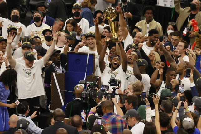 The Milwaukee Bucks celebrate their first NBA title since 1971 on Tuesday night at the Fiserv Forum in Milwaukee, Wis., after the team defeated the Phoenix Suns in six games. Photo by Tannen Maury/EPA-EFE