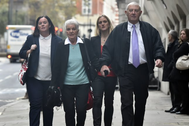 Members of Jo Cox's family, including mother Jean Leadbeater (C, L) sister Kim Leadbeater (C,R) and father Gordon Leadbeater (R) arrive at the Old Bailey for the trial of Thomas Mair in London, Britain, on Wednesday. Mair was convicted of murdering Member of Parliament Jo Cox. Photo by Hannah McKay/European Press Agency