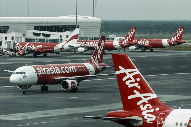 AirAsia aircraft are seen at Kuala Lumpur International Airport 2 in Malaysia on July 1, 2016. A flight headed to the airport was forced to return to Perth, Australia, on Sunday after engine troubles. Photo by Ahmad Yusni/EPA
