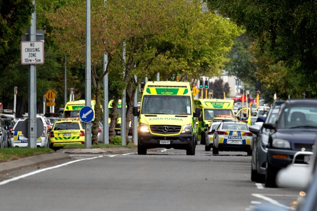 Ambulances and police respond to a shooting at a mosque in Christchurch, New Zealand, on March 15. Attacks at two mosques killed 50 people. Photo by Martin Hunter/EPA-EFE