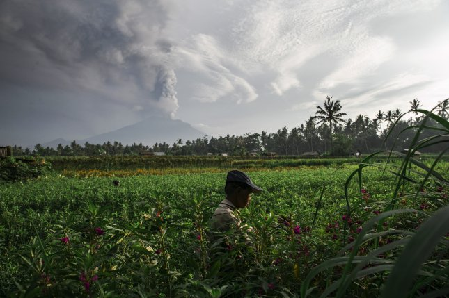 Aerosols spewed by volcanos can cool temperatures by reflecting the sun's rays. But new research showed the effect can also curb crop growth by limiting the amount of solar energy available to plants. Photo by EPA-EFE/MADE NAGI