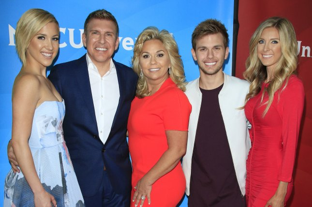 Lindsie Chrisley (R), pictured with sister Savannah Chrisley, dad Todd Chrisley, mom Julie Chrisley and brother Chase Chrisley,split from her husband, Will Campbell, after nine years of marriage. File Photo by Nina Prommer/EPA