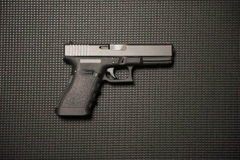 .45-caliber Glock handgun. Photo by Nic Neufeld/Shutterstock.com