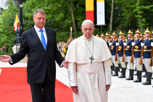 Pope Francis meets with Romanian President Klaus Iohannis during a welcome ceremony at the Cotroceni Presidential Palace in Bucharest, Romania on Friday. Photo by Ettore Ferrari/EPA-EFE