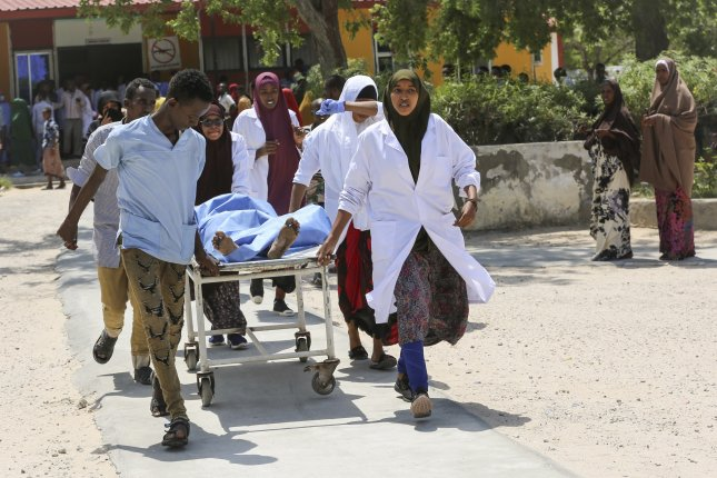 A casualty is rushed to a Mogadishu hospital Monday after a car bomb attack that killed at least 17. Photo by Yusuf Warsame/EPA-EFE