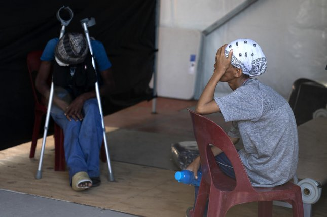 Homeless South Africans wait for coronavirus testing at a temporary shelter site in Cape Town, South Africa, Thursday. Photo by Nic Bothma/EPA-EFE