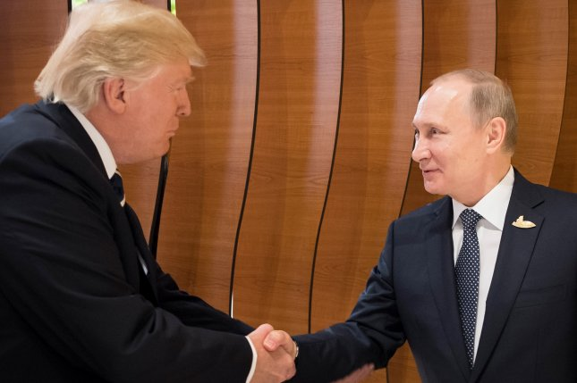 Putin reportedly bonded with Trump by mocking the press