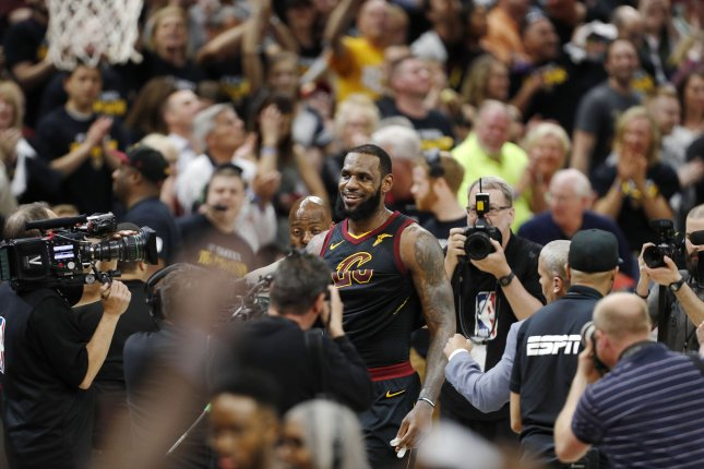521bd6765cd8 Cleveland Cavaliers forward LeBron James (C) walks off the court after the  NBA Eastern Conference semifinals basketball Game 3 between the Toronto  Raptors ...